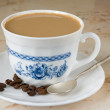 Cup of white coffee — Stock Photo