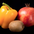 Fruits and pepper isolated on black — Stock Photo