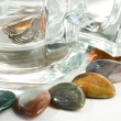 Stock Photo: Semi-precious stones and empty beer mug