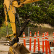 Royalty-Free Stock Photo: Backhoe Bucket and Construction Barriers