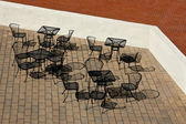 Outdoor Cafe Tables and Chairs — 图库照片
