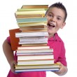Stock Photo: Happy boy with stack of books