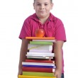 Boy with stack of books — Stock Photo