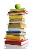 Stack of books with green apple — Stock Photo