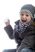 Boy throwing a snow ball — Stock Photo