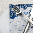Stock Photo: Fork and knife on napkin