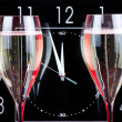 Champagne and clock - Stock Photo