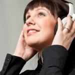 Woman Listening to music — Stock Photo #12403749