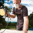 Carpenter sanding wood with sander — Stock Photo #12274168
