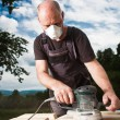 Stock Photo: Carpenter sanding a wood with sander
