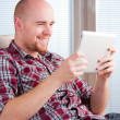Stock Photo: Man with tablet computer