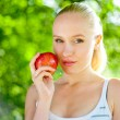 Young woman with an apple — Stock Photo