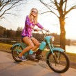Young beautiful woman riding a lifestyle vintage bike during sun — Stock Photo #12280045