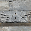 Stock Photo: Carving of Pisa naval ships on the side of the leaning tower of Pisa