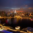 Night scene of financial district Singapore from roof Marina Bay Hotel. — Stock Photo