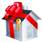 Little house with red ribbon and golden key