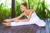 Graceful woman stretching doing yoga