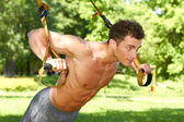 Attractive fittness man doing exercises