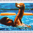 Постер, плакат: Postage stamp Umm al Quwain 1972 Mark Spitz Winner of the Olymp