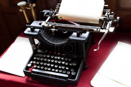 Постер, плакат: Old typewriter and paper on writers desk, холст на подрамнике