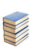 Hromádky knih izolovaných na bílém