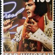 Постер, плакат: TAJIKISTAN CIRCA 2000: A stamp printed in Tajikistan shows Elvis Presley circa 2000