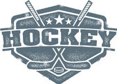 Crossed hockey sticks and puck in this vintage style crest