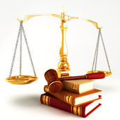 Wooden law gave on pile of colorful book