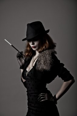 Retro shot of gangster woman in fedora hat