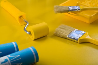 Tools fot painting on yellow table