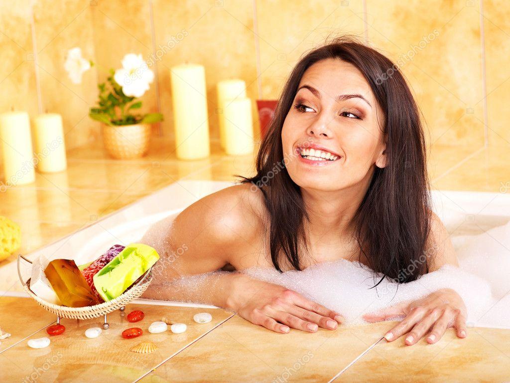 Woman bathing in bathroom
