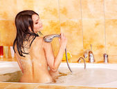 Photo Young woman take bubble bath.