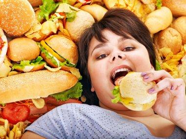 Woman eating hot dog.