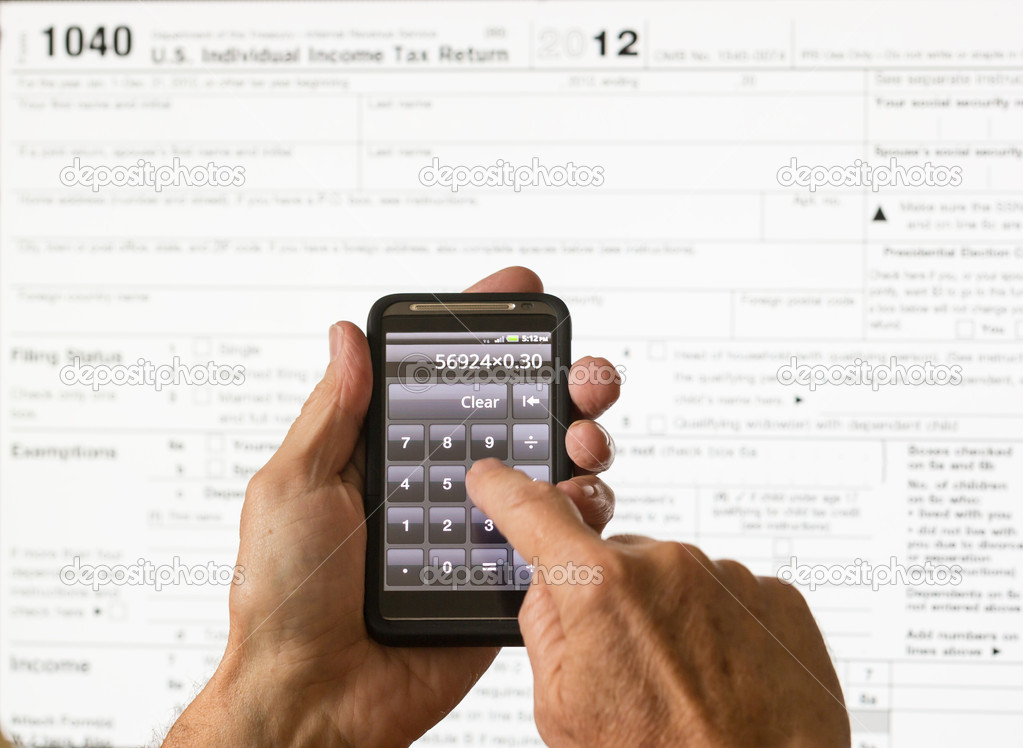 Usa Tax Form 1040 For Year 2012 And Calculator Stock Photo