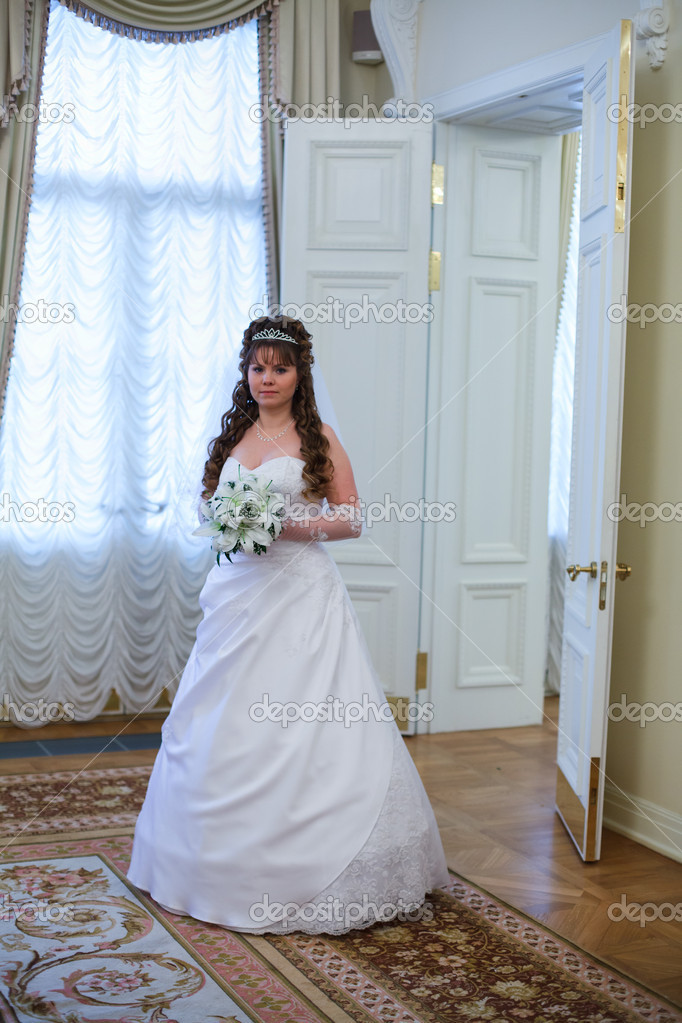 Beautiful Caucasian Russian bride in white dress and with lilies ...