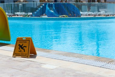Sign slippery floor by the pool