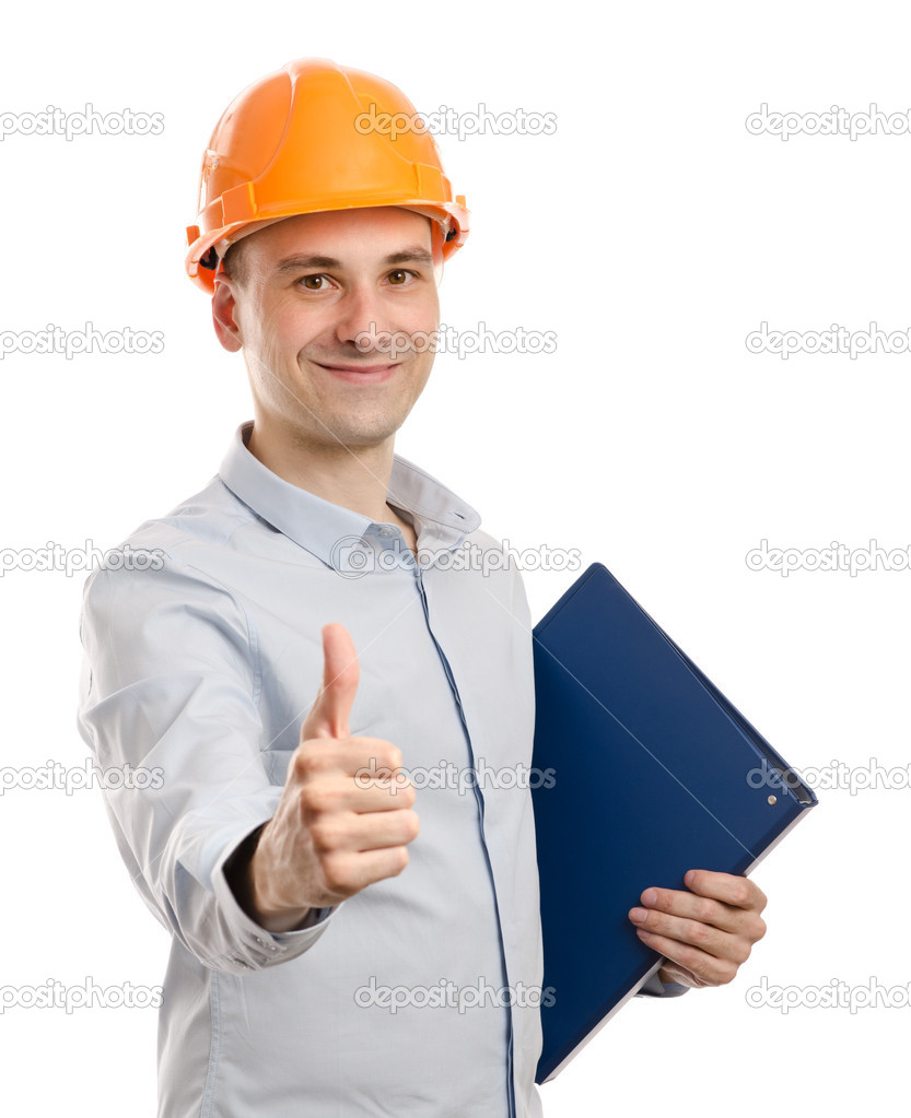 Portrait of young positive manual worker thumbs up