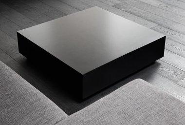 Black square coffee-table, modern interior detail