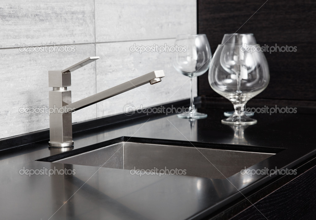 black marble kitchen modern kitchen sink with metal tap and black marble stock photo
