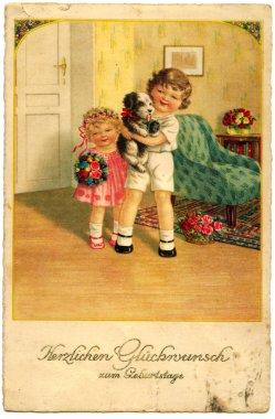 Boy and girl with dog.