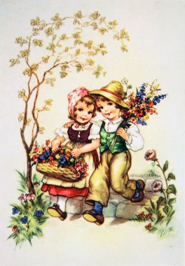 Children with flowers in their hands in the garden