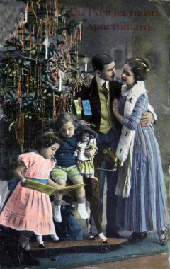 RUSSIA - CIRCA 1913: Postcard printed in Russia shows family near Christmas tree, circa 1913