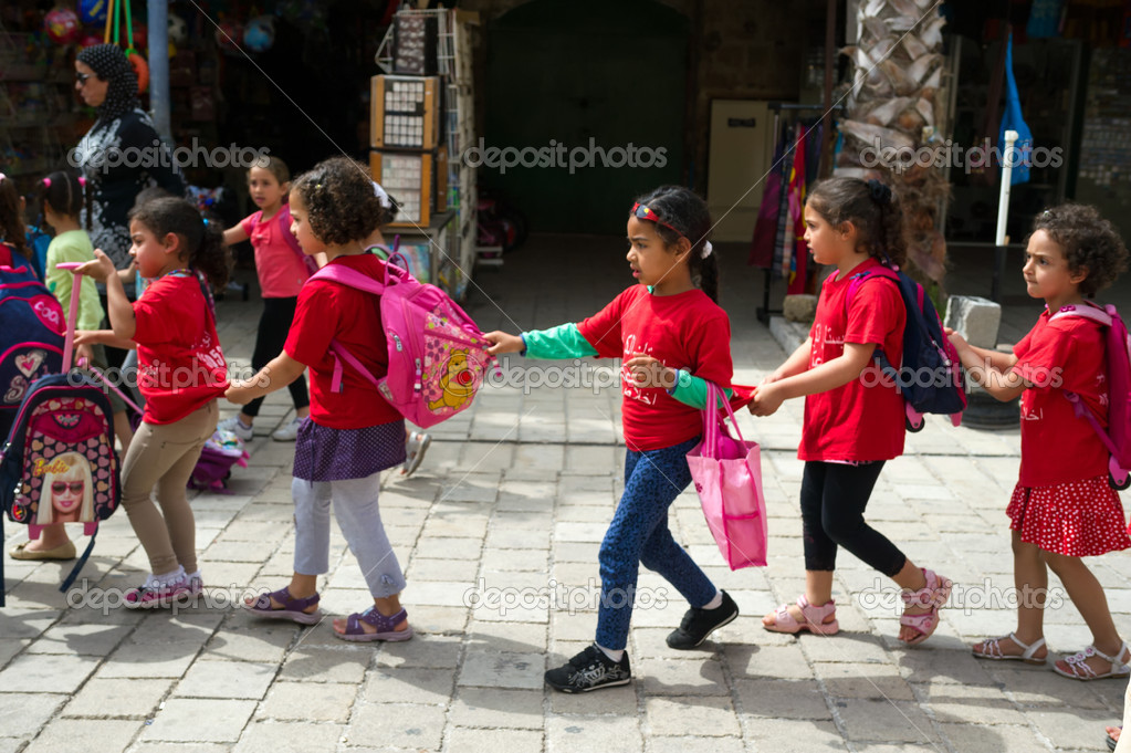 Little arabic girls going to school - Stock Editorial