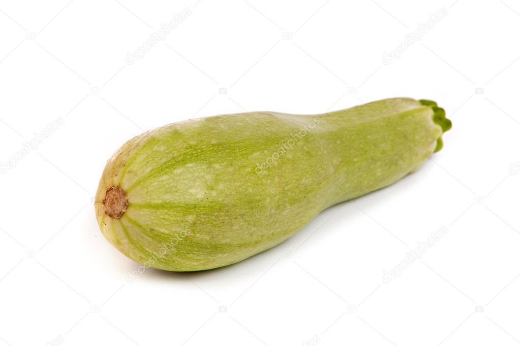 Courgette or zucchini. Isolated on white.