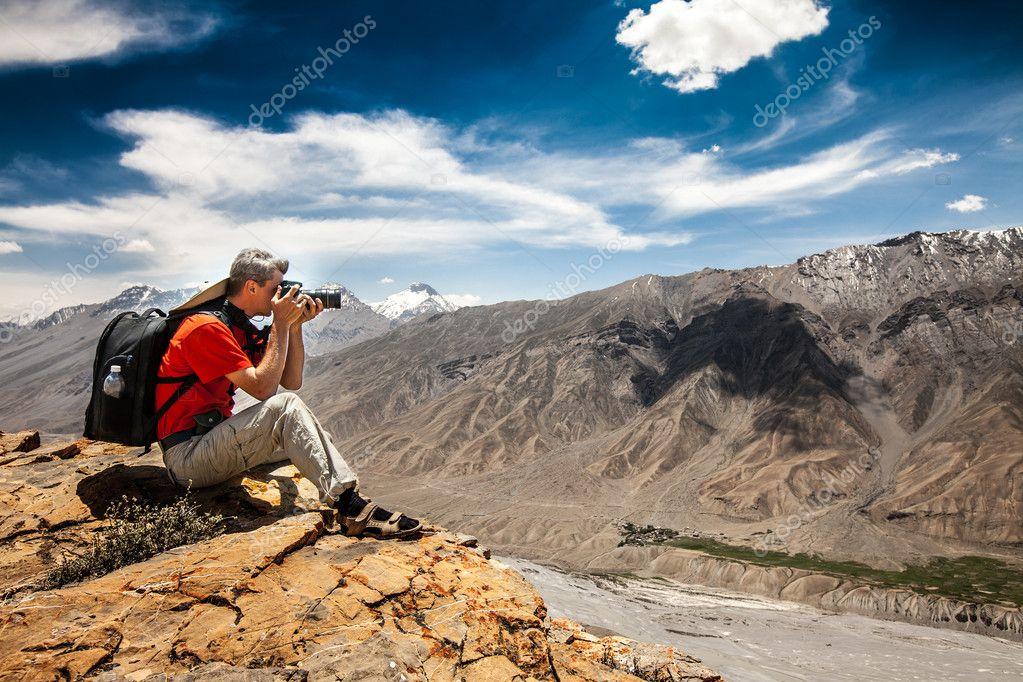 Photographer on the high mountain