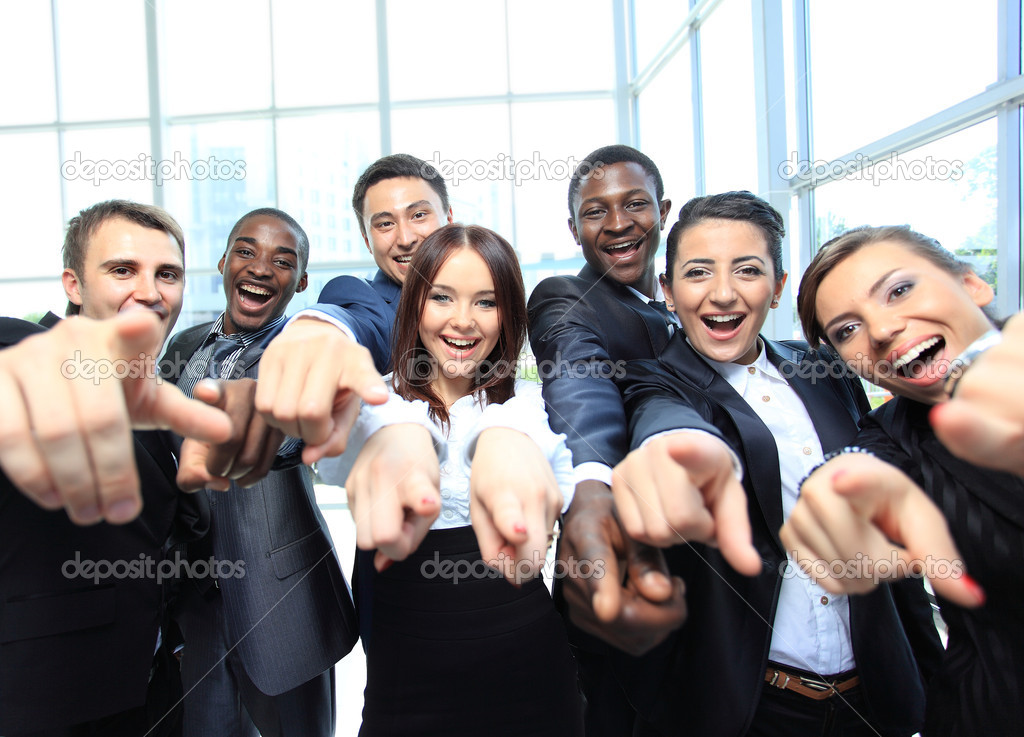 Portrait of excited young business pointing at you