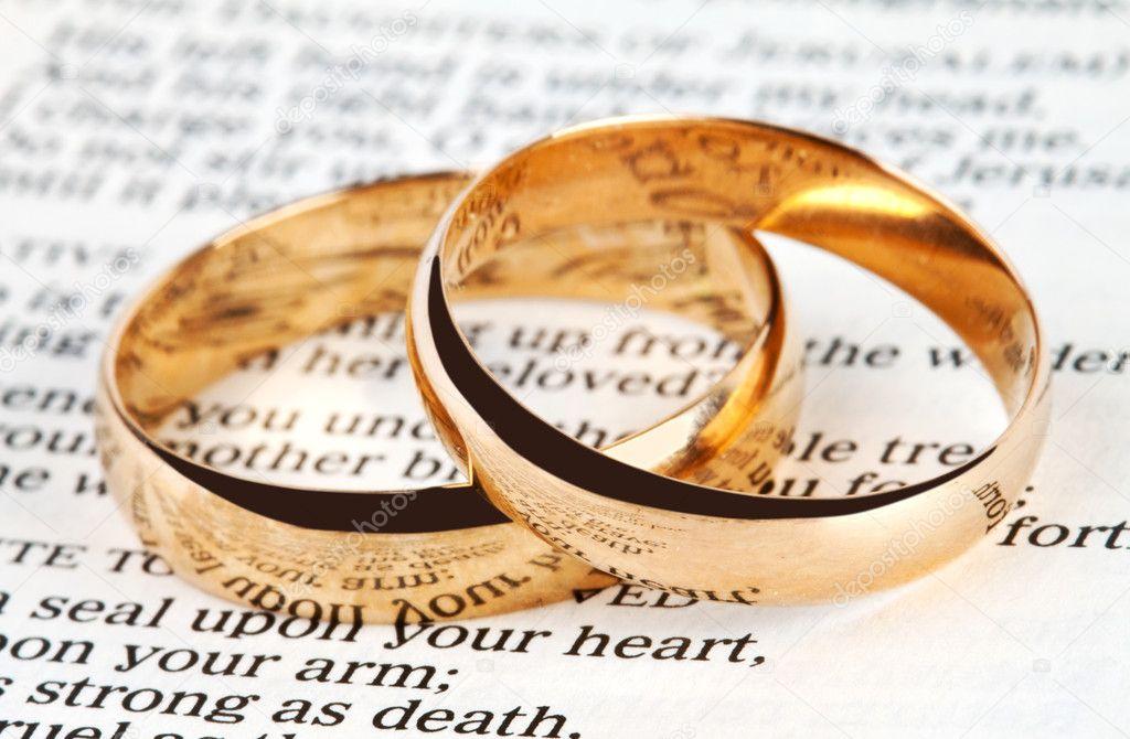 Two wedding rings on a bible Stock Photo Olegkalina 11158351