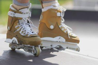 In-line skater in outdoor skatepark