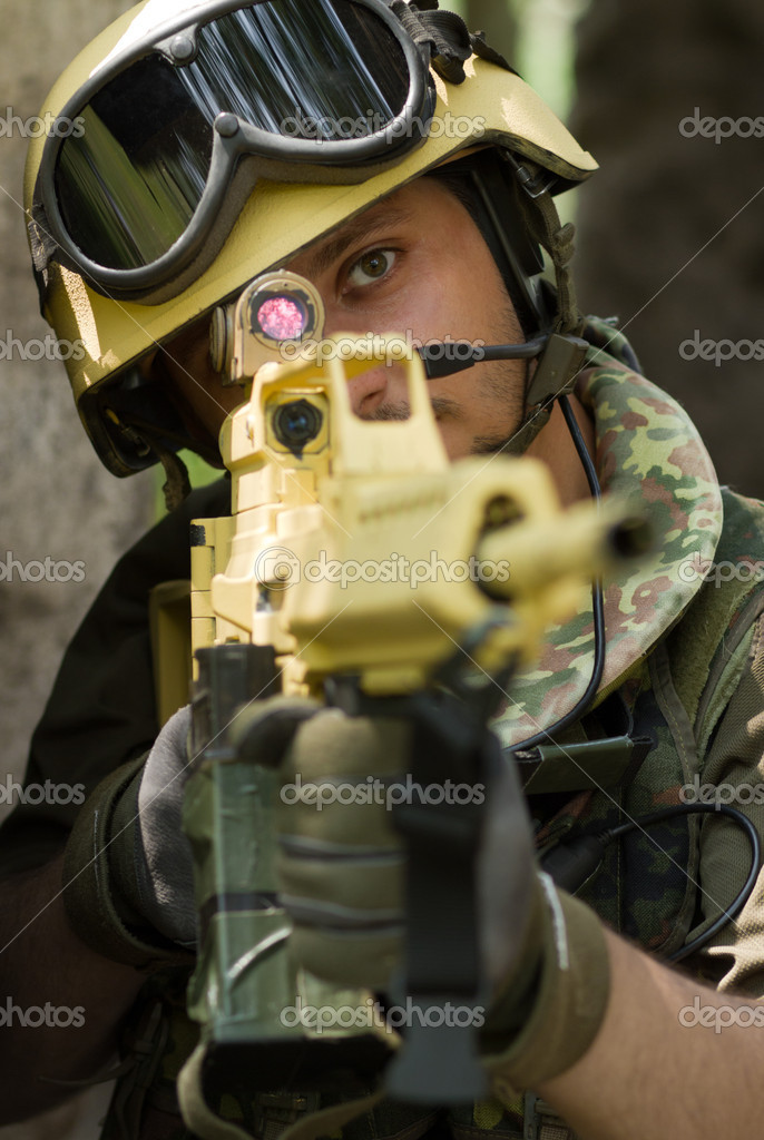 Portrait of a soldier targeting with a rifle