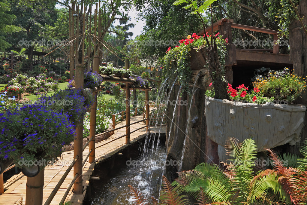 Bamboo path between the fountain and flower beds